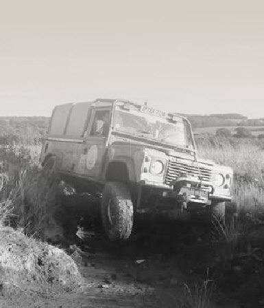 Land Rover Defender 110 with wheel in air on trial